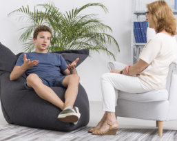 young man explaining to an adult woman